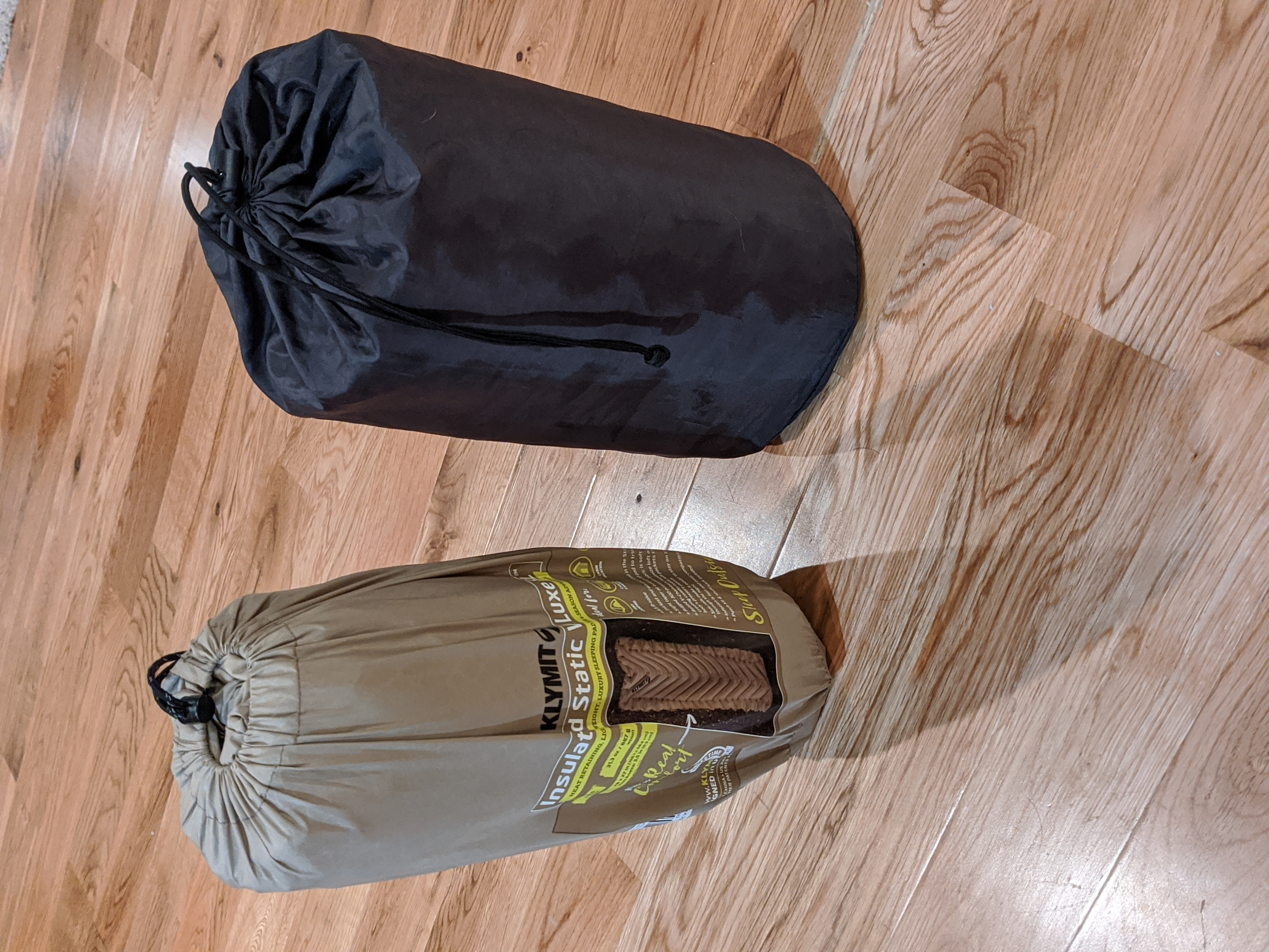 The Klymit Static V Luxe packs down to roughly the same form factor if a little smaller than the Thermarest.