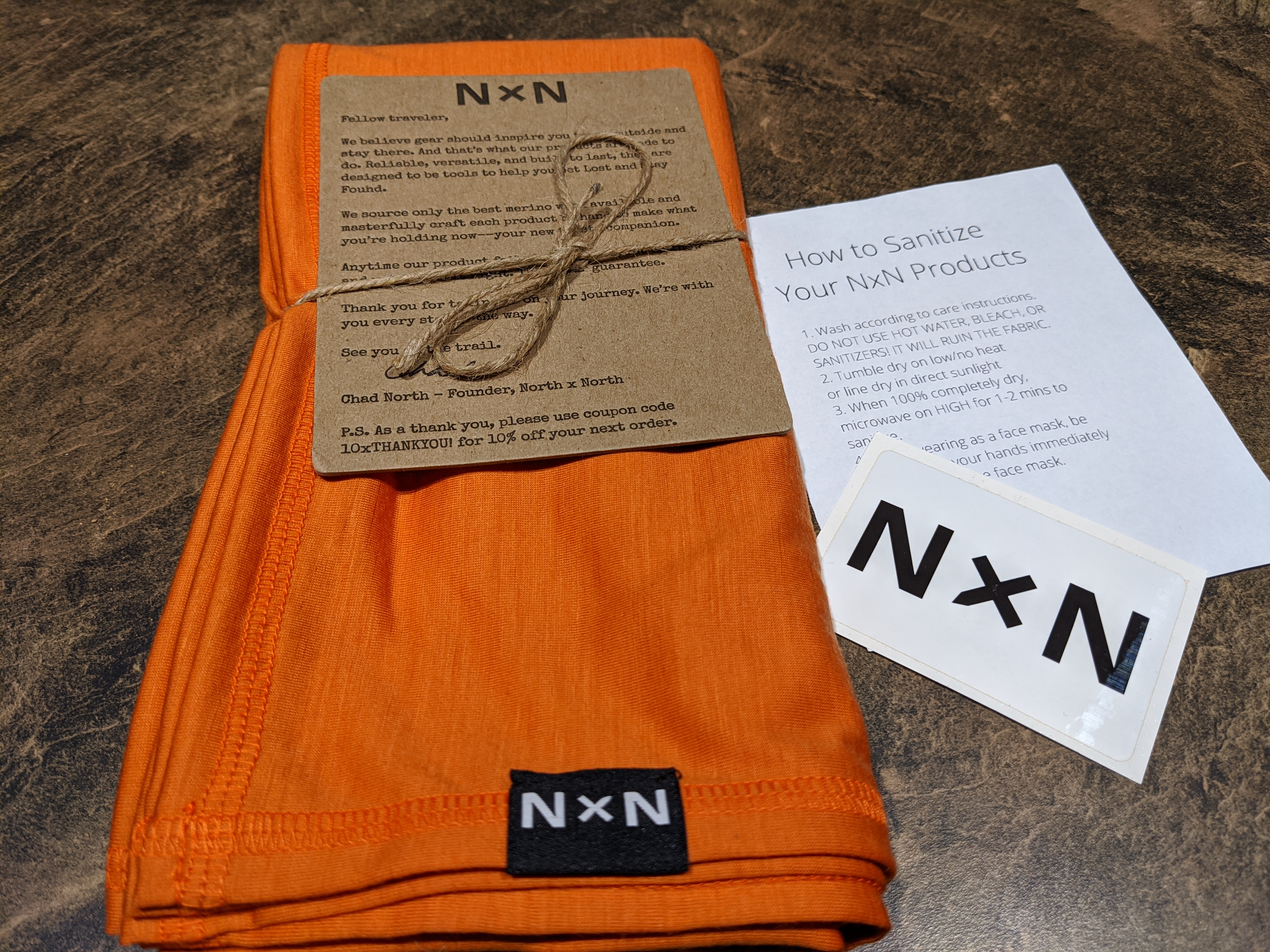 The Merino wool kerchief in cayenne arrived neatly packaged with care instructions and sticker.