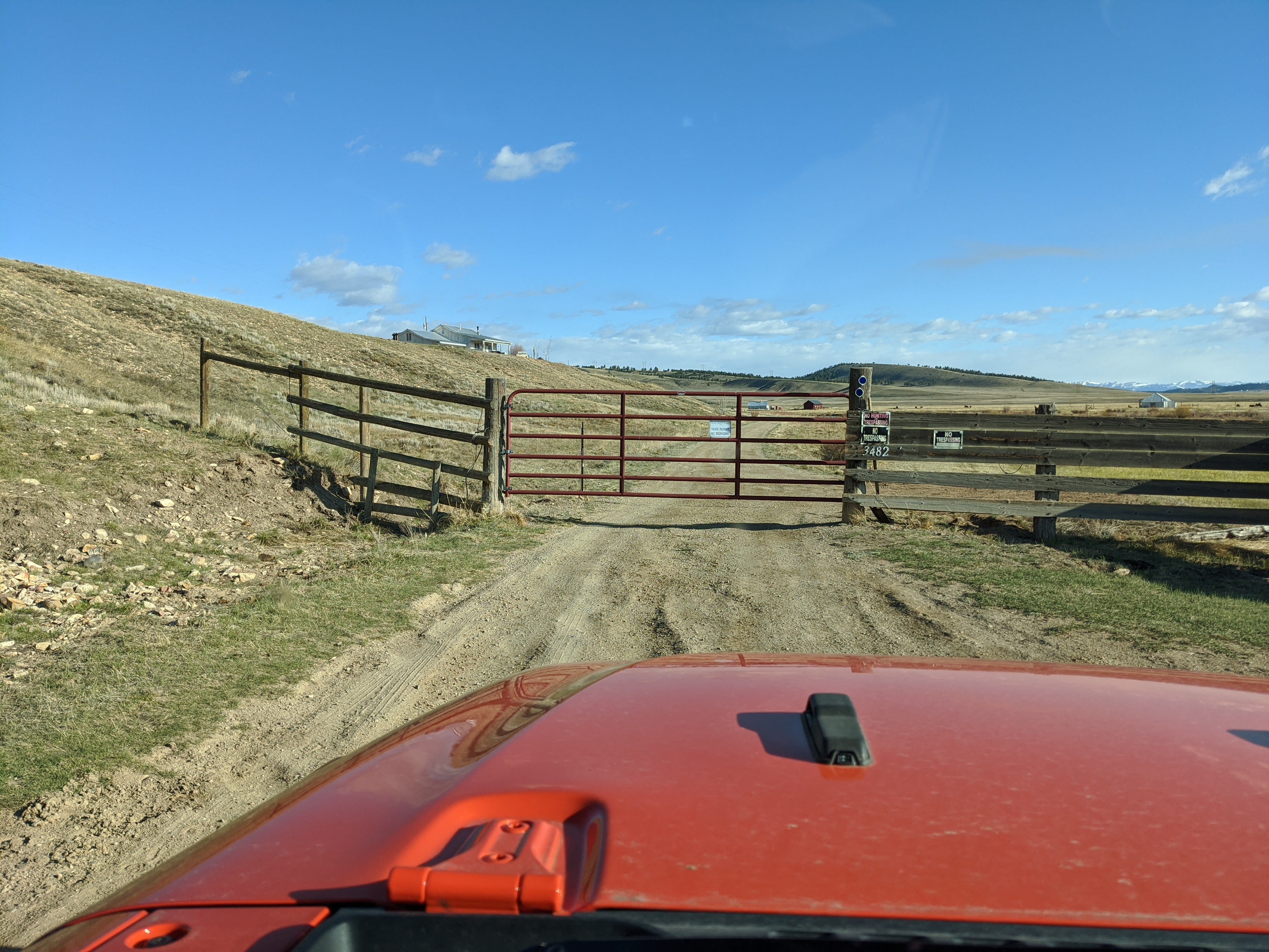A closed and locked gate on a county road only found through doing ground truth scouting.