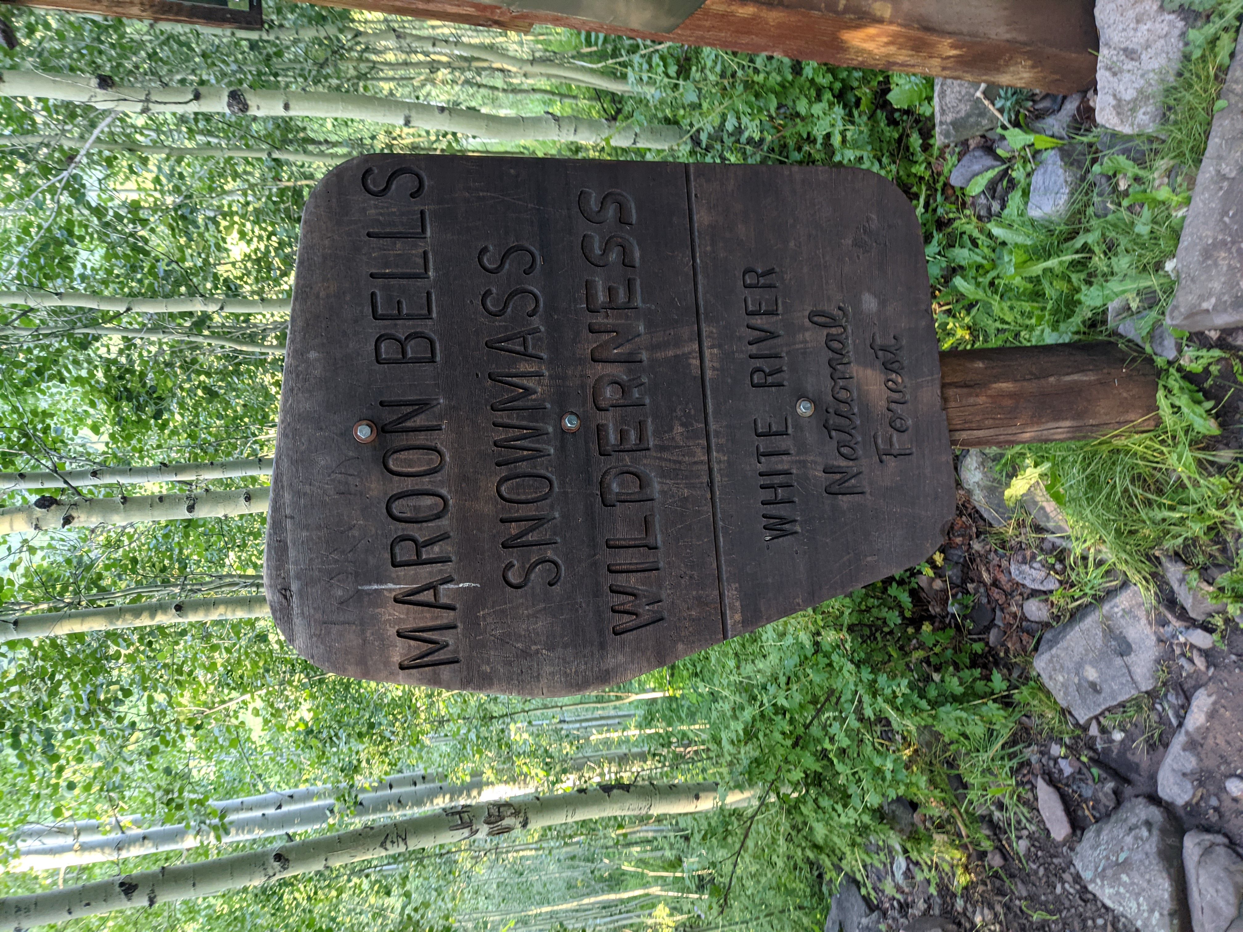 The Maroon Bells Wilderness Sign, we're now on the trail, heading towards the Four Pass Loop.